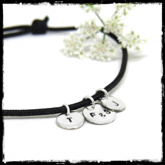 Sterling silver tassel bracelet on customizable black silk cord
