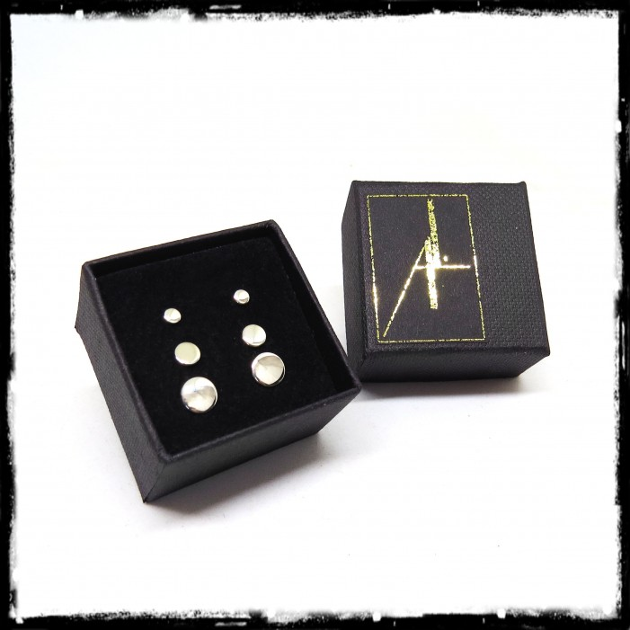 Small minimalist round earstudss in sterling silver mirror polished finish