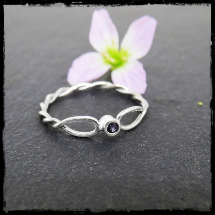 Fine braided ring in sterling silver gold and gemstone